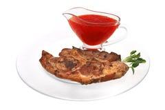 Lamb steak on ribs with thai sauce Royalty Free Stock Photo