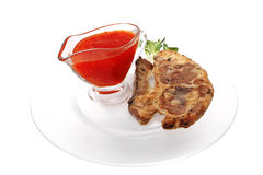 Lamb steak on ribs with thai sauce Royalty Free Stock Photography