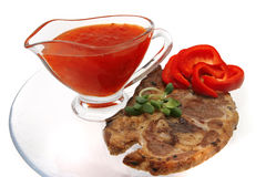 Lamb steak and sauce Royalty Free Stock Photos
