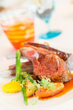 Lamb steak with sauce and boiled vegetables Royalty Free Stock Images