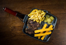 Lamb steak. Served with polenta and chips royalty free stock image