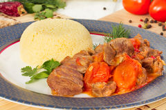 Lamb stew in Arabic with vegetables and dried apricots. Stock Image