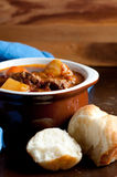 Lamb stew with cloverleaf buns. Hearty home made stew with lamb and fresh vegetables and buns for dipping Stock Photo