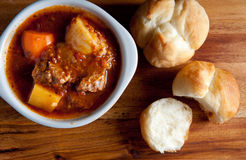 Lamb stew with cloverleaf buns. Hearty home made stew with lamb and fresh vegetables and buns for dipping Royalty Free Stock Images