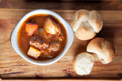 Lamb stew with cloverleaf buns Royalty Free Stock Image