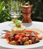 Lamb stew with rice. A healthy and simple recipe for beef with fesh basil, safran and rice Stock Photo