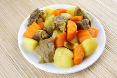 Lamb stew. Rich hearty lamb stew with potatoes and carrots ready to serve Royalty Free Stock Photography