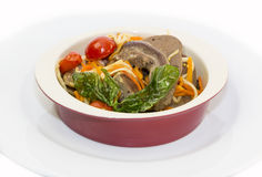 Lamb tongues. Braised lamb tongues with pasta and vegetables Royalty Free Stock Photos