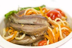 Lamb tongues. Braised lamb tongues with pasta and vegetables Royalty Free Stock Photography