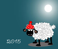 Lamb under the moon. The amusing lamb in a red cap costs under the moon at night. Symbol of 2015 Royalty Free Stock Image