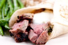 Lamb wrap in a soft homemade flatbread Stock Photo