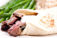 Lamb wrap in a soft homemade flatbread Royalty Free Stock Photo