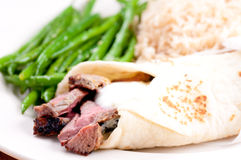 Lamb wrap in a soft homemade flatbread Royalty Free Stock Photography