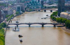 Lambeth Bridge across River Thames, London, England. Aerial view of Lambeth Bridge area of  River Thames at low tide, central London Royalty Free Stock Image