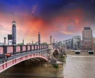 Lambeth Bridge, London. Beautiful red color and surrounding buil. Dings at sunset Stock Photos