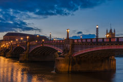 Lambeth Bridge London. Lambeth Bridge over river Thames in  London at night with public ligths on Stock Photo