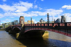 Lambeth Bridge London. Lambeth Bridge is a road traffic and footbridge crossing the River Thames in an east-west direction in central London, the river flows Royalty Free Stock Photo