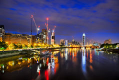 Lambeth Bridge looking west. View of London at night from Lambeth Bridge showing St Georges Wharf and St Georges Tower cranes and River Thames Royalty Free Stock Image