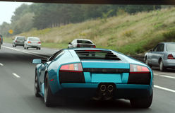 Lamborghini. Expensive sports car on the road royalty free stock photo