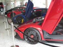 Lamborghini avendator. Four cars Lamborghini avendator with open doors stock photos