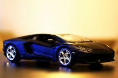 Lamborghini Aventador LP700-4 model car 1:24. Lamborghini Aventador LP700-4 die-cast metal model toy 1:24 scale, Black. Lateral view Stock Images