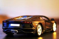Lamborghini Aventador LP700-4 model car rear view. Lamborghini Aventador LP700-4 die-cast metal model toy 1:24 scale, Black. Rear view Stock Photos