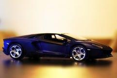 Lamborghini Aventador LP700-4 model car 1:24. Lamborghini Aventador LP700-4 die-cast metal model toy 1:24 scale, Black. Lateral view Stock Image