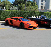 Lamborghini aventador parked at luxury hotel. Lamborghini aventador three quarter view. parked next to rolls Royce convertible at luxury resort in south florida Stock Image