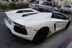 Lamborghini Aventador. The white Lamborghini Aventador on the street of Rodeo Drive in Beverly Hills, LA, CA Royalty Free Stock Photography