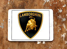 Lamborghini car logo. Logo of lamborghini car brand on samsung tablet on wooden background royalty free stock photos