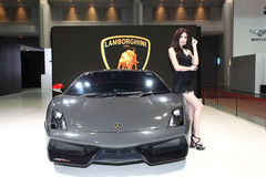 Lamborghini car with Unidentified model on display at Bangkok Stock Photo