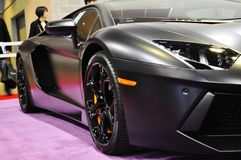 Lamborghini close up. Black Lamborghini on a purple carpet at the Vancouver car show stock image