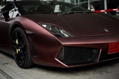 Lamborghini Gallardo coupe cabriolet burgundy color. Lamborghini Gallardo coupe cabriolet hard top speedster V10 burgundy front side view -Bangkok Thailand Royalty Free Stock Photos
