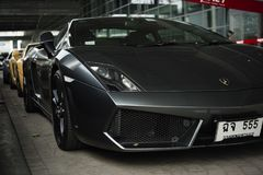 Lamborghini Gallardo coupe cabriolet grey. Lamborghini Gallardo coupe cabriolet hard top speedster V10 dark grey color front side view -Bangkok Thailand November Royalty Free Stock Photo