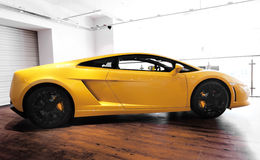 Lamborghini Gallardo Sports car. Yellow Lamborghini Gallardo sports car side profile Royalty Free Stock Images