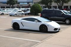 Lamborghini Gallardo. A white Lamborghini Gallardo parked in a shopping center Royalty Free Stock Images