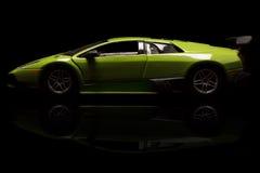 Lamborghini. KRIVOY ROG, UKRAINE - JAN 04 - Toy lamborghini Murcielago on black backgrond, Saturday 4 January 2014 Royalty Free Stock Photography