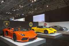 Lamborghini, Lotus and Bugatti luxury sport cars. NEW YORK - APRIL 24, 2014: Lamborghini, Lotus and Bugatti luxury sport cars on display in New York. All tree Stock Photography