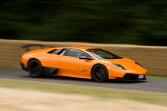 Lamborghini murcielago 670 super veloce. Orange Lamborghini murcielago 670 super veloce on track at goodwood festival of speed Stock Image
