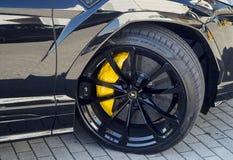 Lamborghini Urus. Details of the immense 23` wheels and the very powerful yellow brake calipers of the Lamborghini Urus royalty free stock image