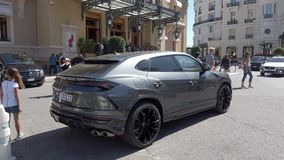 Lamborghini Urus SUV Rear View. Monte-Carlo, Monaco - May 1, 2019: Luxury Grey Lamborghini Urus SUV Rear View Parked At Monte-Carlo Casino Square In Monaco stock video footage