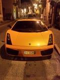 Lamborghini. A yellow Lamborghini at night on the street Royalty Free Stock Images