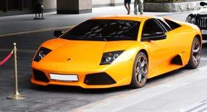 Lamborgini mette in mostra l'automobile arancione Fotografia Stock