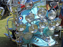 Lambretta spotlights. Photo of 1960`s iconic lambretta vespa motorcycle covered in spotlights at the whitstable classic car show 16th july 2017 stock photography