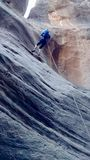 Repelling down Lambs Knoll Outside of Zion National Park. Lambs Knoll is a popular spot for commercial canyoneering. This is a ground view of someone repelling royalty free stock image