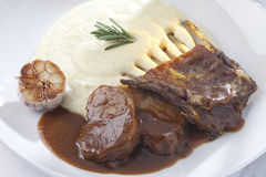 Lambs ribs and potatoe mash with roasted garlic Royalty Free Stock Images
