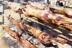 Lambs on spits roasting Royalty Free Stock Image
