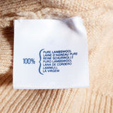 Lambswool label. Pure lambswool label on wool jumper Royalty Free Stock Photo