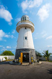 Lamchareon Lighthouse. A tower type of structure designed to emit light from a system of lamps and lenses and used as a navigational aid for maritime pilots at Royalty Free Stock Image
