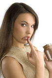 Lamedura del chocolate poner crema Imágenes de archivo libres de regalías